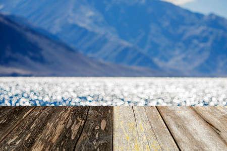 on wood floor: wood floor and lake background.