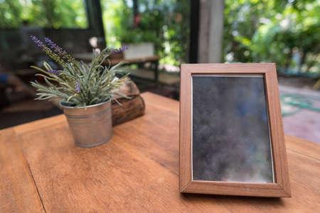 mocked: Menu frame on table in restaurant cafe shop.