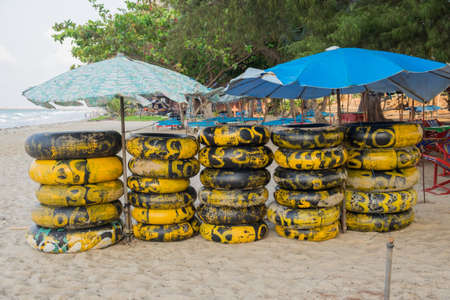 rayong: Rubber ring on the beach for rent Rayong ,Thailand. Stock Photo