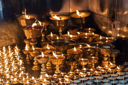 shree: Lighting a lamp for peace from Shree Boudhanath Kathmandu ,Nepal.