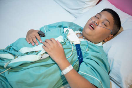 Asian boy wearing Sleep Apnea Diagnostic medical device Kit. Sleep Lab Test.