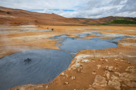 Bubbling Hot with steam. Mud Pots in the Namafjall Geothermal Area, Hverir, Iceland.
