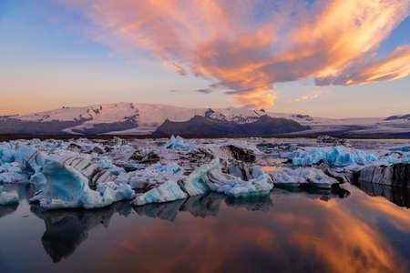 Icebergs in Jokulsarlon glacier lagoon. Vatnajokull National Park, Iceland Summer. Midnight Sun. Stock Photo