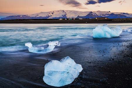 Ice rock on the black sand beach at Diamond Beach, Iceland Summer.