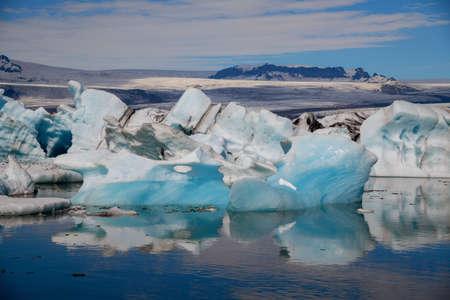 Icebergs in Jokulsarlon glacier lagoon. Vatnajokull National Park, Iceland Summer.Midnight Sun. Фото со стока