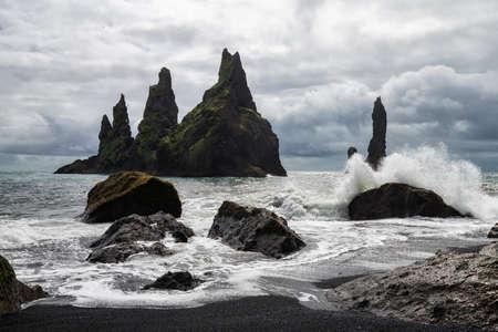 Basalt rock formations Troll toes on black beach. Reynisdrangar, Vik, Iceland
