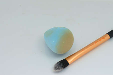 Professional make-up brush and sponge with foundation