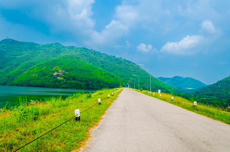 Beautiful colorful perspective road with mountain and sky background photo