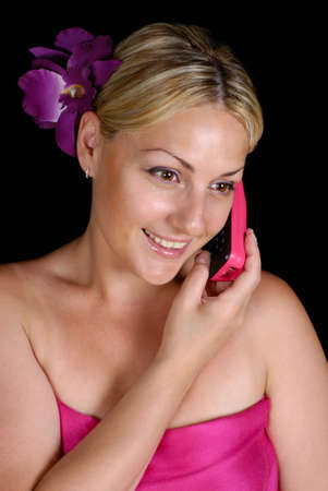 Blonde girl on a black background on the phone