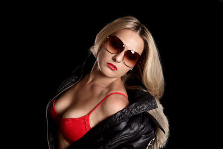 Beautiful girl in red underwear, sunglasses and a jacket. Stock Photo