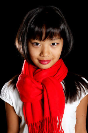 Cute girl in a red scarf Stock Photo
