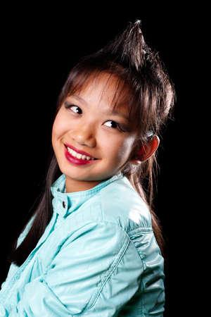 hair tuft: Playful Asian girl with a tuft of hair on his head