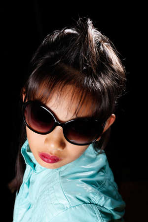 girl in sunglasses with a crest on its head