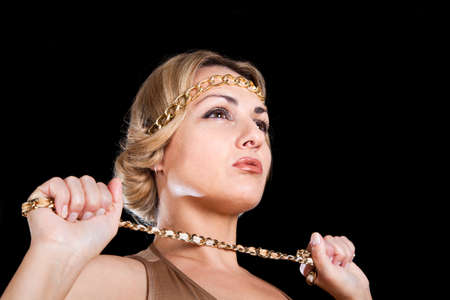 beautiful blonde in a Greek style keeps the chain in his hand  Stock Photo - 15262828