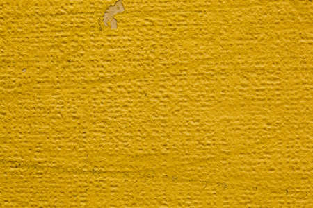 Textured yellow wall  Rough, not smooth surface  photo