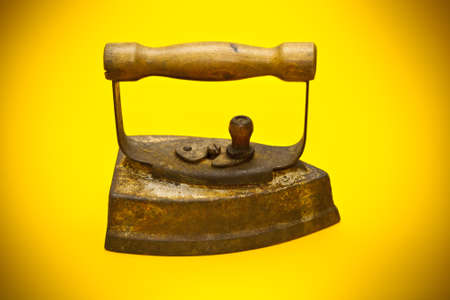 antiquary: old iron on a yellow background