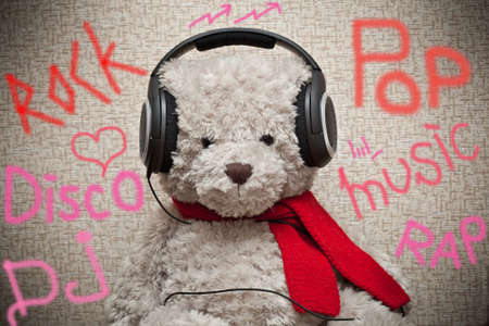 Bear music fan listens to music on headphones photo