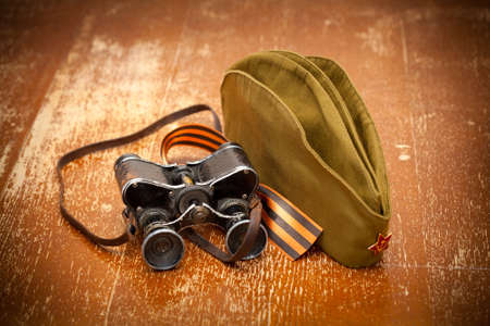 Victory Day on May 9. Military binoculars, field cap, George Ribbon. retro Style