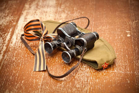 Victory Day on May 9. Military binoculars, field cap, George Ribbon. retro Style. 70 Years of Victory