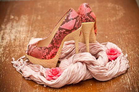 fashionable shoes pink with pink flowers and a scarf photo