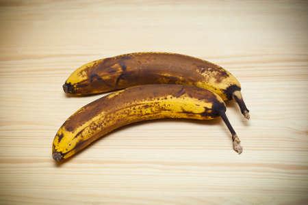 Old banana on wooden board photo
