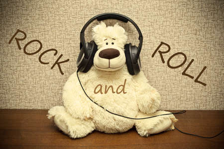 Teddy bear with headphones. Amateur rock and roll photo