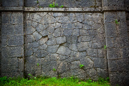 Ancient stone wall of the castle. texture of rough stone Stock Photo