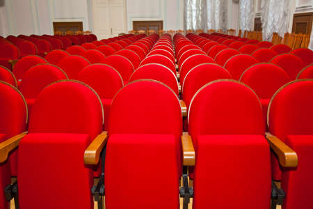 without people: Empty hall without people. red empty chairs