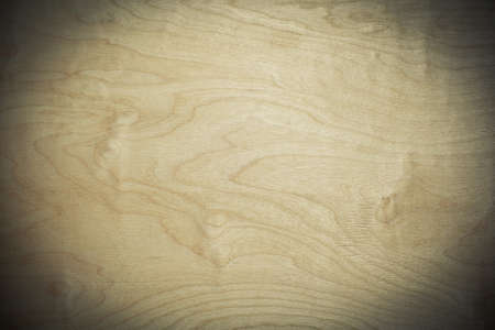 vignetting: Background of wood texture. Photo toned in yellow, applied vignetting