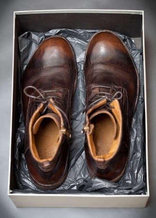 Expensive fashion men leather shoes in a store box