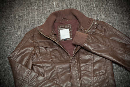 Fashionable leather jacket brown close-up on a dark background