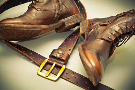 Fashionable shoes handmade leather belt with a buckle. grunge style. cowboy style