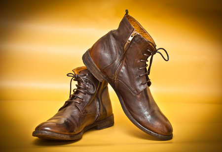 Men shoes in retro style on a yellow abstract background