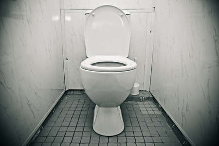 Toilet in the bathroom of economy class