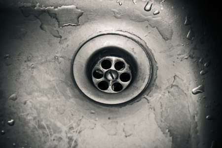 sink hole: Drain hole in a dirty sink close up