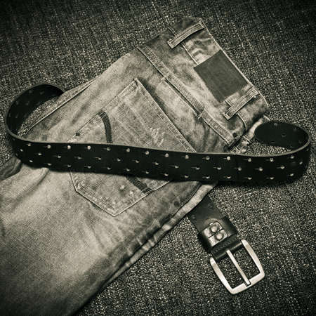 Details of clothes - fashion jeans, a leather belt with a buckle Stock Photo