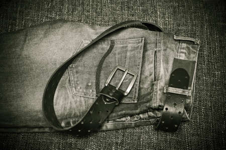 Fashion trend - jeans, a leather belt with a buckle