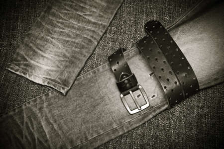 Fashion jeans, a leather belt with a buckle. Black and white photo in retro style Stock Photo