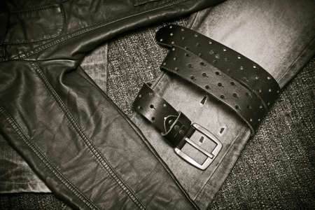 Fashion trend - jeans, leather jacket, leather belt with a buckle Stock Photo
