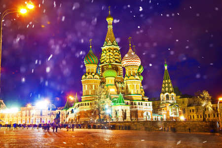 snow falls: Attractions Moscow - St. Basils Cathedral on Red Square. Winter city landscape, snow falls