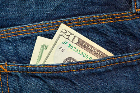 dollars in the back pocket of jeans Stock Photo
