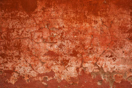 Rough surface concrete walls. Abstract red background. Concrete wall with cracks and scratches. Texture vintage stone surface