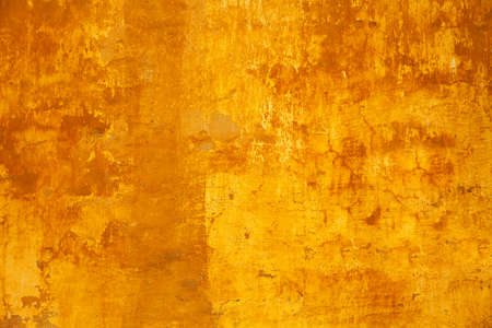 Background texture of the old rough concrete surface yellow. Design basis - Background. Empty space