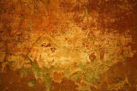 Old concrete texture. Rustic background. Orange - red bright wall with cracks