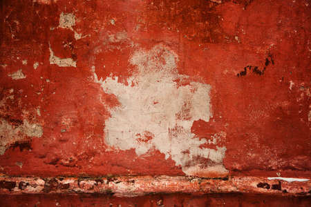 Red old wall. abstract background texture concrete wall. Paint peels from the surface of the wall. Empty space