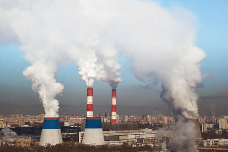 smokestacks: Massive white smokes coming out of many factory chimneys