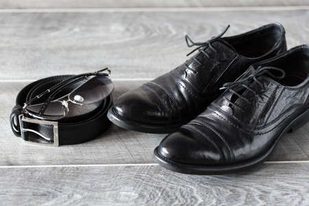 Mens modern fashion. Classic leather shoes, belt and sunglasses