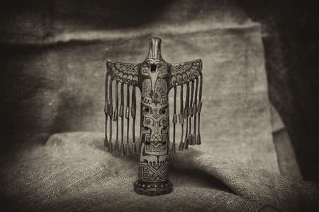 totem in the form of a bird. Vintage style Stock Photo