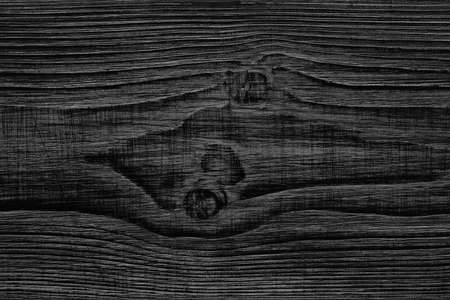 Background, texture, cut down a tree. Beautiful pattern of the wooden surface, dark tonality
