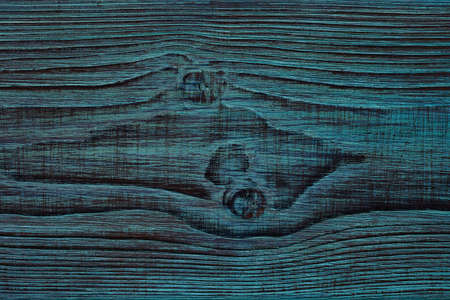 Knots of wood. Background, the texture of beautiful wood, artificially aged, painted blue. Background to a darker tone Stock Photo